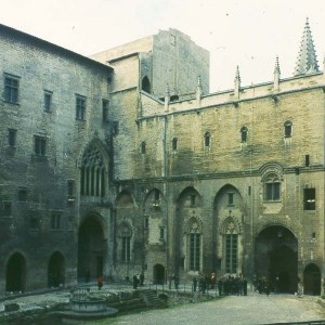 The central courtyard of the Papal palace in Avignon. The expanding Papal bureaucracy in this French city attracted many Italians who were seeking employment. Petrarch's father brought the family here in 1312.
