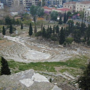 The theater of Dionysius is carved out of the rocky promontory that hosts the Acropolis and nestles down below the Parthenon on the south side of the hill. Here Athens came to enjoy the plays of Sophocles which are still performed in the theater, 2400 years after Sophocles died.
