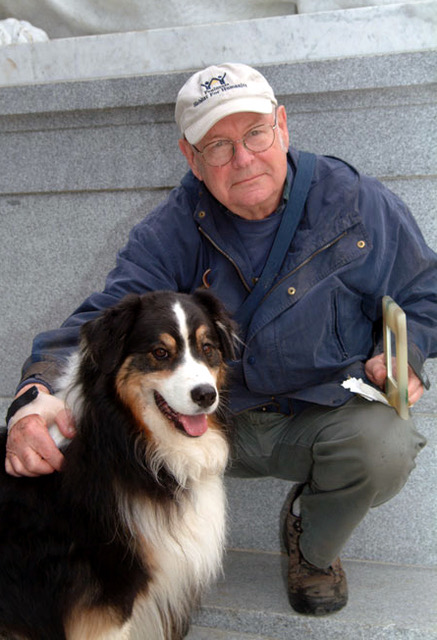Van A. Harvey with his dog